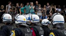 The riot squad stands by as student block an entrance to the Universite de Montreal Monday, August 27, 2012 in Montreal. (Paul Chiasson/THE CANADIAN PRESS)