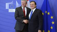 Canadian Prime Minister Stephen Harper shakes hands with President of the European Commission Jose Manuel Barroso in Brussels on Friday Oct. 18, 2013, after announcing a free-trade agreement between Canada and the Europe Union. Ten months after this declaration of a 'historic moment,' Ottawa quietly announces reaching final negotiated deal. (Adrian Wyld/The Canadian Press)