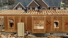 Workers build a new house in Alexandria, Virginia February 16, 2012. (KEVIN LAMARQUE/KEVIN LAMARQUE/REUTERS)
