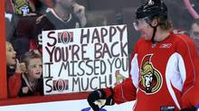 In a Sunday, Jan. 13, 2013 file photo, Ottawa Senators team captain Daniel Alfredsson acknowledges two young fans who show their appreciation for his team coming back after the NHL hockey lockout ended at training camp in Ottawa, Ontario. (The Canadian Press)