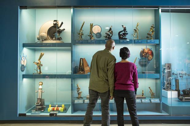 Two museum visitors browse an exhibit in the centre's 'Artifact Alley.'