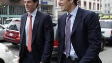 Cameron, left, and Tyler Winklevoss leave the 9th Circuit Court of Appeals after a hearing on a settlement dispute with Facebook's Mark Zuckerberg in San Francisco, Calif., on Jan. 11, 2011. (STEPHEN LAM/REUTERS)
