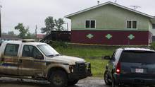 Members of a crime-troubled First Nation south of Edmonton are voting on whether to give community leaders the power to evict suspected gang members. A five-year-old boy was fatally shot in this house on the Samson Cree First Nation reserve Monday morning, July 11, 2011 near Hobbema, Alberta. The boy was the grandson of the Chief Marvin Yellowbird. (Ian Jackson/The Canadian Press/Ian Jackson/The Canadian Press)