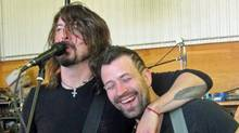 Dave Grohl with Nick Perry of Georgetown, Ont., in Perry's barn