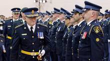New OPP Commissioner Chris Lewis, left, inspects a line of officers during the Change of Command ceremony in Toronto Tuesday, August 31, 2010. (Darren Calabrese/The Canadian Press)