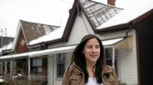 Melissa Hart stands in front of a west end home that was listed for almost $600,000. (Della Rollins for the Globe and Mail/Della Rollins for the Globe and Mail)