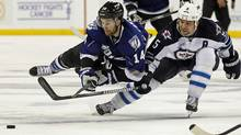 Tampa Bay Lightning's Brett Connolly battles for the puck with Winnipeg Jets' Mark Stuart during the second period of their NHL hockey game in Tampa, Florida October 29, 2011. (MIKE CARLSON/Reuters)