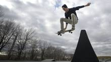 Dominik Gmeiner, 20, gets some air as the mild weather at the Ashbridges Bay skate board park in Toronto, Ont. (Kevin Van Paassen/Kevin Van Paassen/The Globe and Mail)