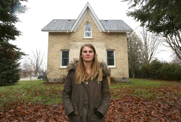 Alyssa Gowing stands outside her house in Belgrave, Ont.