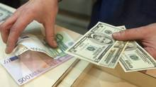 Economist Detlev Schlichter says the world's major currencies are destined to crash. 'The dollar, the euro and the yen are locked in a race to the bottom.' (PHILIPPE DESMAZES/PHILIPPE DESMAZES/AFP/GETTY IMAGES)