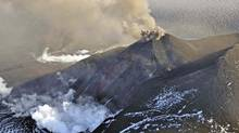 Aerial view of the eruption at Mount Veniaminof's intracaldera cone on the Alaska Peninsula, in this photo taken August 18, 2013. (HANDOUT/Reuters)