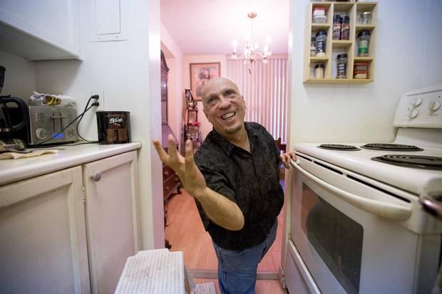 Thalidomide survivor Paul Settle is shown at his Hamilton home.