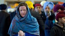 Alberta PC party leader Alison Redford makes a campaign stop at a Sikh temple in Calgary, Alta., Sunday, April 15, 2012. Albertans go to the polls on April 23. (Jeff McIntosh/Canadian Press/Jeff McIntosh/Canadian Press)