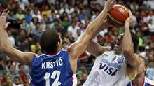 Argentina's Luis Scola has his shot blocked by Serbia's Nenad Krstic (L) during their FIBA World Championship game in Kayseri September 2, 2010. REUTERS/Ivan Milutinovic (IVAN MILUTINOVIC)