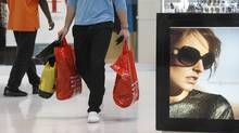 U.S. shoppers spent more freely in last weeks of 2011, latest Beige Book survey shows. (Lynne Sladky/AP)