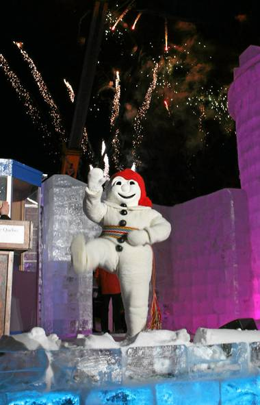 Bonhomme waves at the crowd gathered for opening night fireworks on the Plains of Abraham.