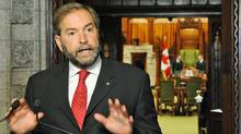 Opposition House Leader Thomas Mulcair speaks to reporters in the foyer of the House of Commons on Sept. 27, 2011. (Sean Kilpatrick/THE CANADIAN PRESS)