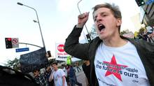 Protesters shout slogans while holding placards during a late afternoon march through downtown Los Angeles on Oct. 3, 2011 in solidarity with Occupy Wall Street protesters in New York City. (FREDERIC J. BROWN/AFP/Getty Images)