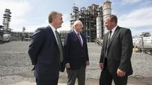 From left: Paul Browning and Arthur Irving, CEO and chairman, respectively, of Irving Oil; and Stefan Pohlod, president for the eastern energy pipeline; gather at the refinery in Saint John after the announcement of a proposed pipeline and marine terminal. (For the Globe and Mail/David Smith)