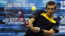 Finland's Jarkko Nieminen returns a shot to Canada's Milos Raonic during their men's singles quarter-final match at the Thailand Open 2012 tennis tournament in Bangkok September 28, 2012. (CHAIWAT SUBPRASOM/REUTERS)