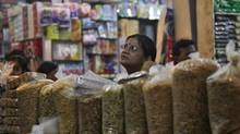 A customer shops at a family owned store at a market in New Delhi September 18, 2012. Thousands of kirana, or general store, owners closed their shops on Thursday to protest against a government decision to allow in foreign supermarkets such as Wal-Mart Stores Inc. (MANSI THAPLIYAL/REUTERS)