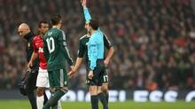 Manchester United's Nani is shown a red card during the Champions League match against Real Madrid (Jon Super/The Associated Press)