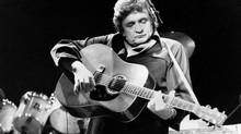 Johnny Cash at Radio City Music Hall in New York, in Feb. 18, 1985. (RON FREHM/AP)
