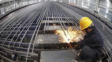 A worker cuts reinforcing bars in a steel factory in Ganyu county, Jiangsu province. China is the world's largest consumer of iron ore. (CHINA DAILY/REUTERS)