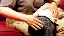 Models depict a reenactment of spanking a child. (Rob Schoenbaum/Rob Schoenbaum/ZUMA Press)