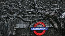 An underground sign is seen through the branches of a snow-covered tree in central London. Shop owners and workers in central London's main shopping destination said trade had been hit heavily by four days of wintry weather. (STEFAN WERMUTH/REUTERS)