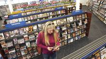A customer browses the offerings in a video store. (Tim Boyle)