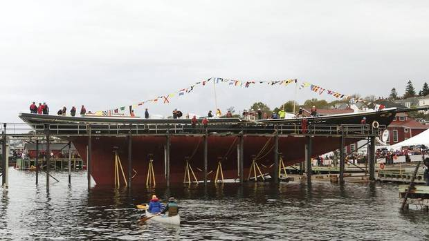 The schooner Bluenose II moves into the water during her launch in Lunenburg, Nova Scotia, September 29, 2012. The 49-year-old schooner has just completed a two-year restoration. (Paul Darrow/Reuters)