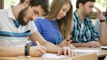 Students working at desks. (LuckyBusiness/Getty Images/iStockphoto)
