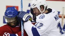 Montreal Canadiens' P.K. Subban takes a hit from Tampa Bay Lightning's Ryan Malone during second period NHL pre-season action Saturday. (Jacques Boissinot/The Canadian Press)