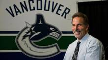 Vancouver Canucks' head coach John Tortorella laughs during an interview following a news conference after he was hired by the NHL team in Vancouver, B.C., on Tuesday June 25, 2013. (DARRYL DYCK/THE CANADIAN PRESS)