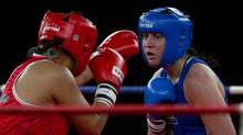 Canadian boxer Mary Spencer (blue) and Mexican boxer Alma Nora Ibarra (red) compete at the Women's Elite Continental Championships in Cornwall, Ont. Wednesday, April 4/2012. (Kevin Van Paassen/The Globe and Mail/Kevin Van Paassen/The Globe and Mail)