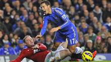 Manchester United's Wayne Rooney makes a late tackle on Chelsea's Eden Hazard to earn himself a yellow card during their English Premier League soccer match at Stamford Bridge in London October 28, 2012. Manchester United won 3-2. The two teams face each other again in League Cup play on Wednesday. (TOBY MELVILLE/REUTERS)