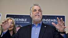 Quebec Liberal Party Leader Philippe Couillard speaks to supporters during a campaign stop on April 5, 2014, in Beauceville, Que. (Jacques Boissinot/The Canadian Press)