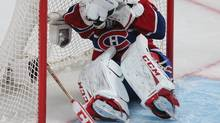 Montreal Canadiens goalie Carey Price reacts on the net after being hit by teammate Jarred Tinordi during the second period of their NHL Eastern Conference Quarterfinals hockey game against Ottawa Senators in Montreal, May 3, 2013. (CHRISTINNE MUSCHI/REUTERS)