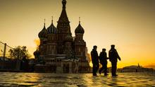 Police patrol Red Square in front of St. Basil's Cathedral in Moscow, January 21, 2014. Security in Russia is on high alert after several bombings and threats leading up to the 2014 Winter Olympic Games in Sochi. (John Lehmann/The Globe and Mail)
