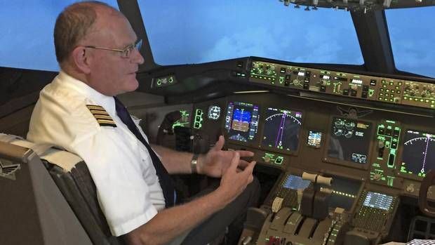 Capt. Rob Johnson sits in the pilot's seat in a simulator at uFly in Mississauga, Ont.