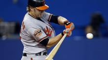 Baltimore Orioles Mark Reynolds hits an RBI single against the Toronto Blue Jays during the eighth inning of their MLB American League baseball game in Toronto, September 4, 2012. (MARK BLINCH/REUTERS)