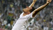 Germany's Mario Gomez celebrates after scoring against Portugal during their Group B Euro 2012 soccer match at the new stadium in Lviv, June 9, 2012. (THOMAS BOHLEN/REUTERS)