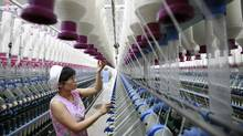A labourer works at a textile mill in Huaibei, Anhui province. (STRINGER/CHINA/REUTERS)