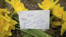 Flowers lie outside Lakeland Sawmill in Prince George, B.C., April 25, 2012 to remember the two people who died after a fire and explosion at the mill. (John Lehmann/John Lehmann/Globe and Mail)
