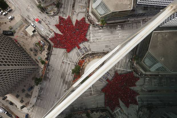 July 1, 2017: Winipeggers assemble into a 'living leaf' at Portage and Main.