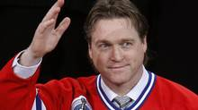 Former Montreal Canadiens hockey goalie Patrick Roy waves during a ceremony to retire his number 33 jersey in Montreal, November 22, 2008. Roy, a hall of fame goalie, led the Canadiens to two Stanley Cups. FILE: REUTERS/Shaun Best (CANADA) (Shaun Best/Reuters)