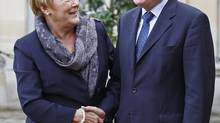 French Prime Minister Jean Marc Ayrault, right, greets Quebec Prime Minister Pauline Marois, prior to their meeting in Paris, Oct. 16, 2012. (Remy de la Mauviniere/AP)
