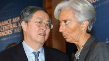 French finance Minister Christine Lagarde, right, talks with China Central Bank Governor Zhou Xiaochuan during the opening session of the G20 Finance summit in Paris, Saturday, Feb. 19, 2011. (Miguel Medina/AP/Miguel Medina/AP)
