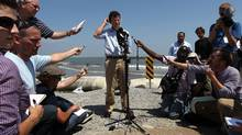 BP CEO Tony Hayward answers media questions on an oil-stained beach in Louisiana. (JOHN MOORE/GETTY IMAGES)